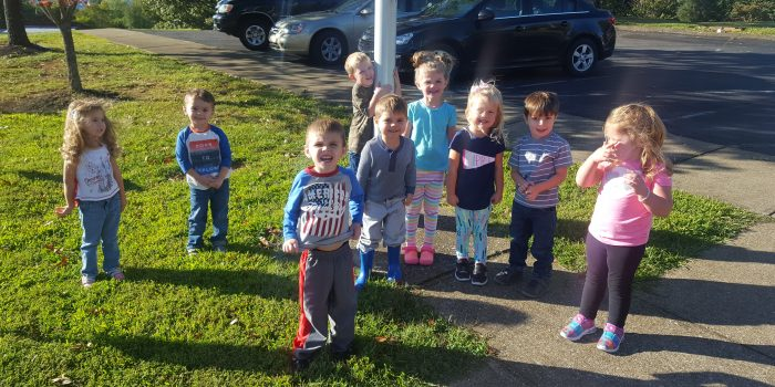 Preschoolers at the flagpole